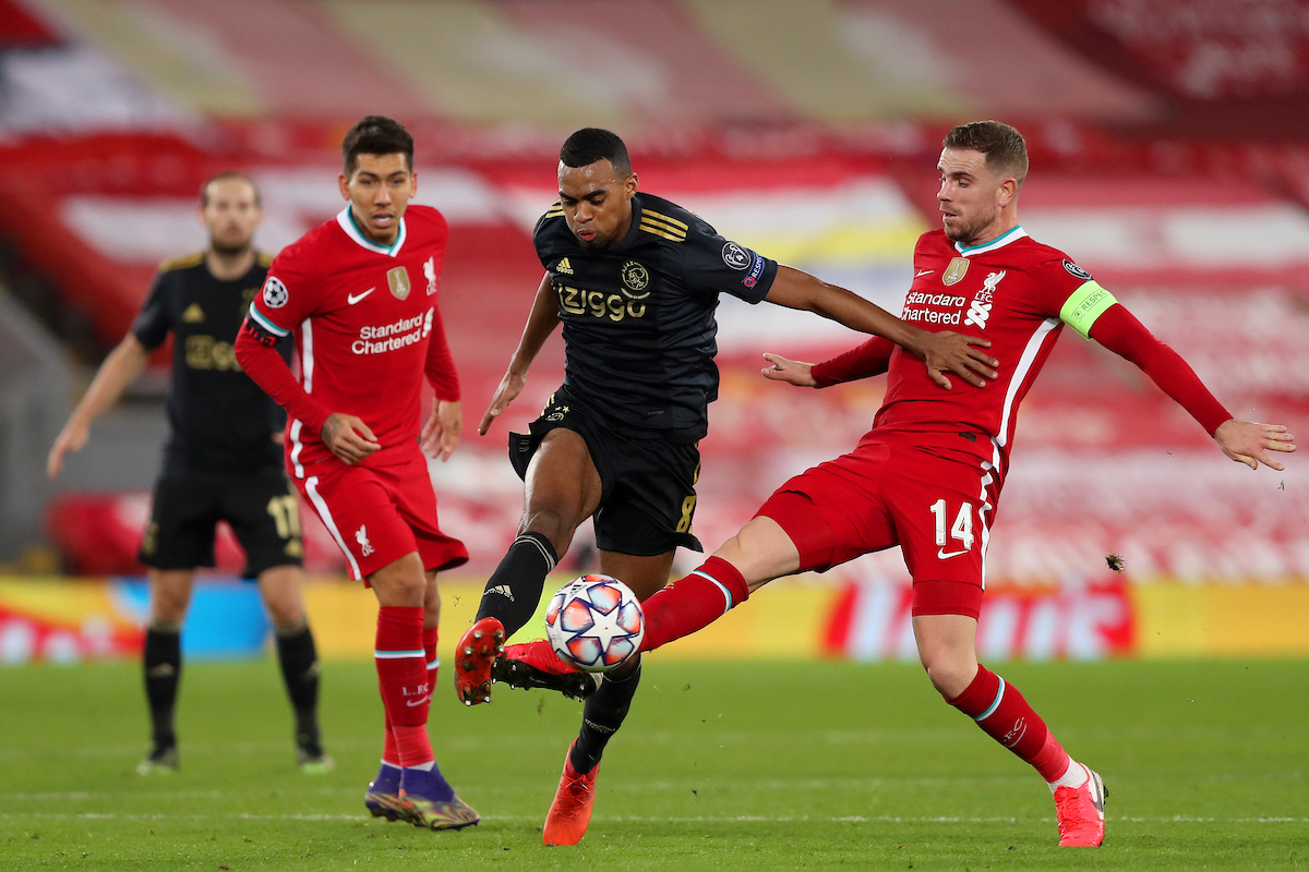 Liverpool's captain Jordan Henderson and Ajax's Ryan Gravenberch during the UEFA Champions League Group D match between Liverpool FC and AFC Ajax at Anfield