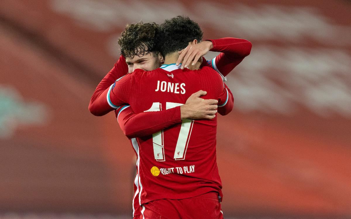 Liverpool's Curtis Jones celebrates with team-mate Neco Williams after scoring during the UEFA Champions League Group D match between Liverpool FC and AFC Ajax at Anfield