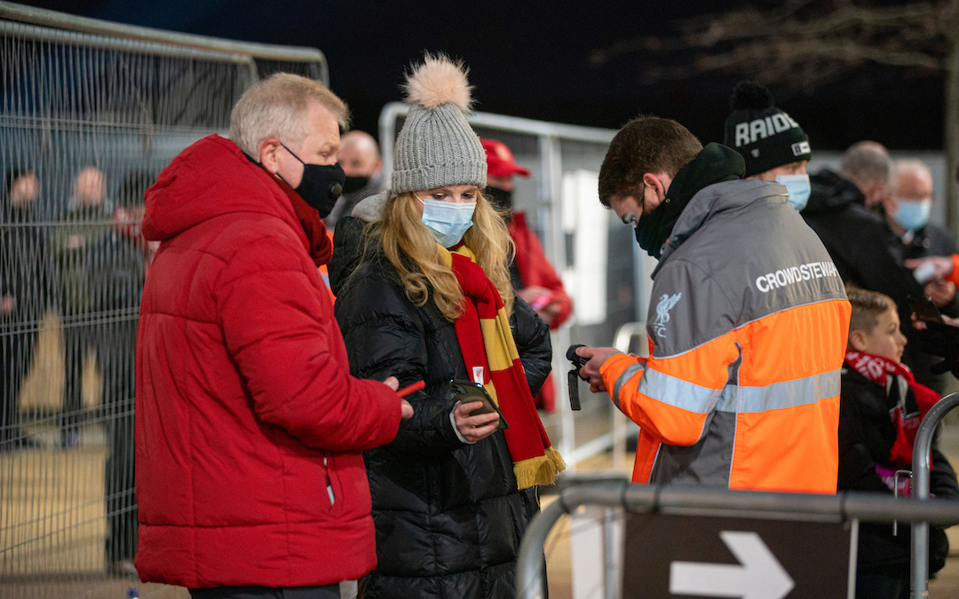 Sunday, December 6, 2020: Liverpool supporters show their electronic tickets on mobile phones as the club welcomes 2,000 spectators back into the stadium, pictured before the FA Premier League match between Liverpool FC and Wolverhampton Wanderers FC at Anfield. Liverpool won 4-0.