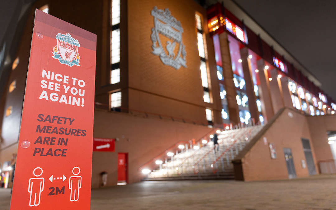 Signage as Liverpool prepares to welcome 2,000 spectators back into Anfield