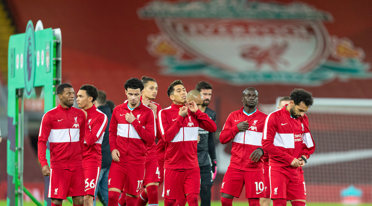 Liverpool players take off their anthem jackets before the FA Premier League match between Liverpool FC and Tottenham Hotspur FC at Anfield