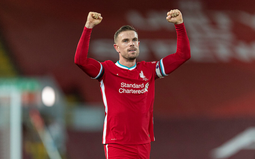 Liverpool's captain Jordan Henderson celebrates at the final whistle during the FA Premier League match between Liverpool FC and Tottenham Hotspur FC at Anfield