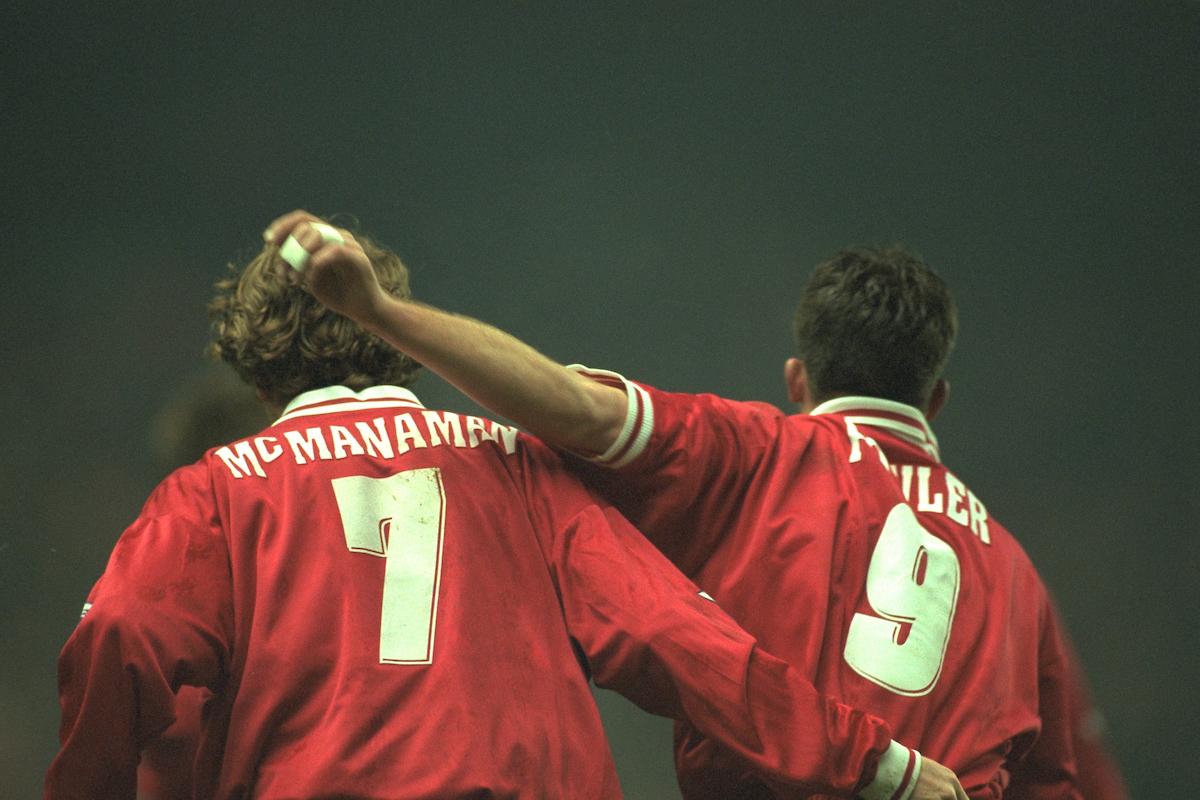 Liverpool's Steve McManaman celebrates scoring with team-mate Robbie Fowler