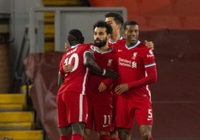 Liverpool's Mohamed Salah celebrates after scoring the first goal during the FA Premier League match between Liverpool FC and Wolverhampton Wanderers FC at Anfield