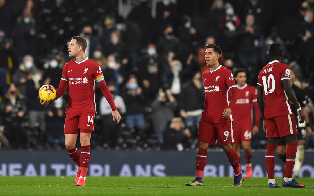 Liverpool players look dejected after Fulham