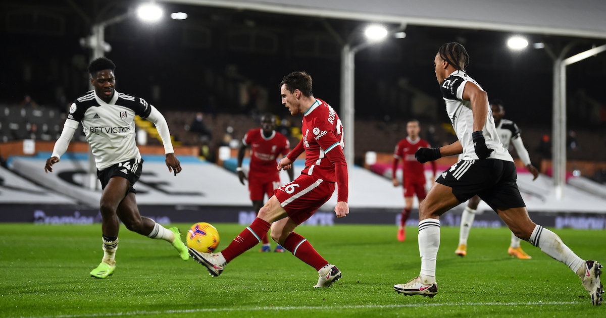 Liverpool's Andy Robertson crosses the ball under pressure from Fulham's Bobby De Cordova-Reid