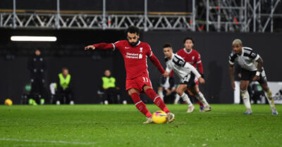 Liverpool's Mohamed Salah scores the first equalising goal from a penalty kick during the FA Premier League match against Fulham FC