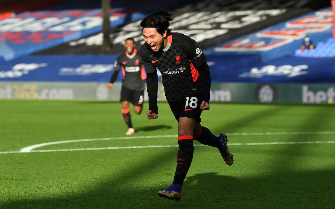 Liverpool's Takumi Minamino celebrates after scoring the first goal during the FA Premier League match between Crystal Palace FC and Liverpool FC at Selhurst Park