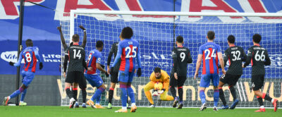 Liverpool's goalkeeper Alisson Becker makes a save during the FA Premier League match between Crystal Palace FC and Liverpool FC at Selhurst Park
