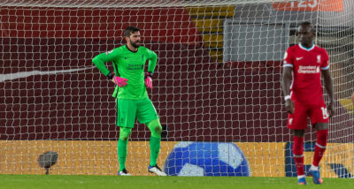 Liverpool's goalkeeper Alisson Becker looks dejected as West Bromwich Albion score the first equalising goal during the FA Premier League match between Liverpool FC and West Bromwich Albion FC at Anfield