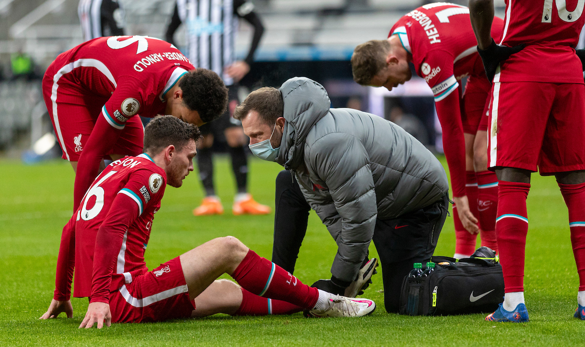 Liverpool's Andy Robertson receives treatment during the FA Premier League match between Newcastle United FC and Liverpool FC at St James' Park
