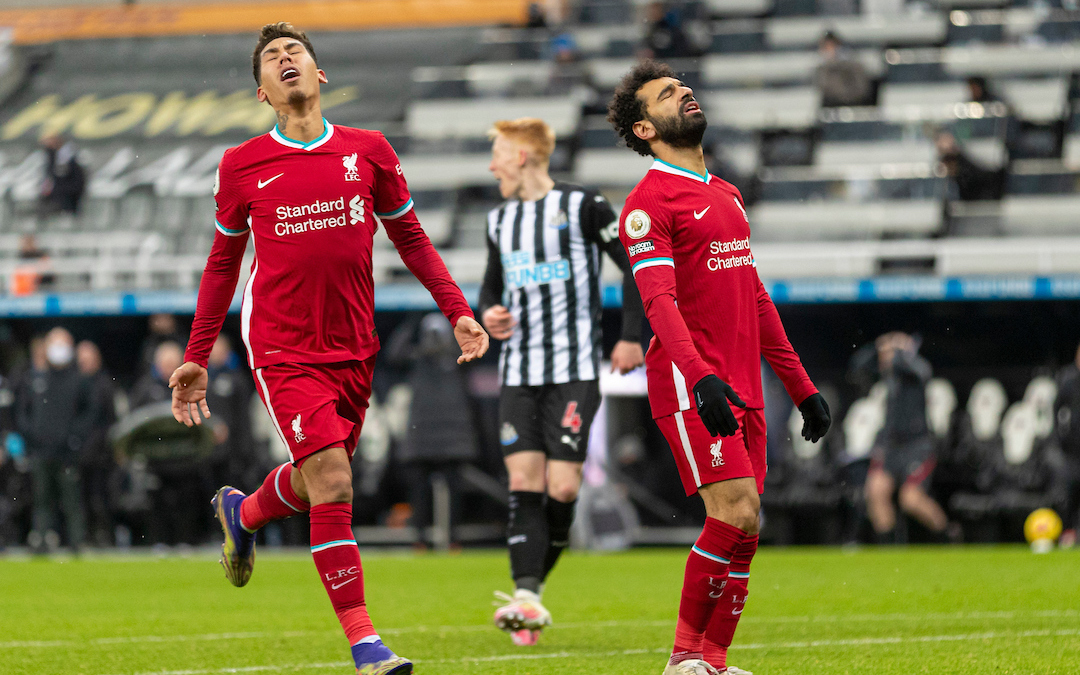 Liverpool's Mohamed Salah and Roberto Firmino look dejected during the FA Premier League match between Newcastle United FC and Liverpool FC at St James' Park
