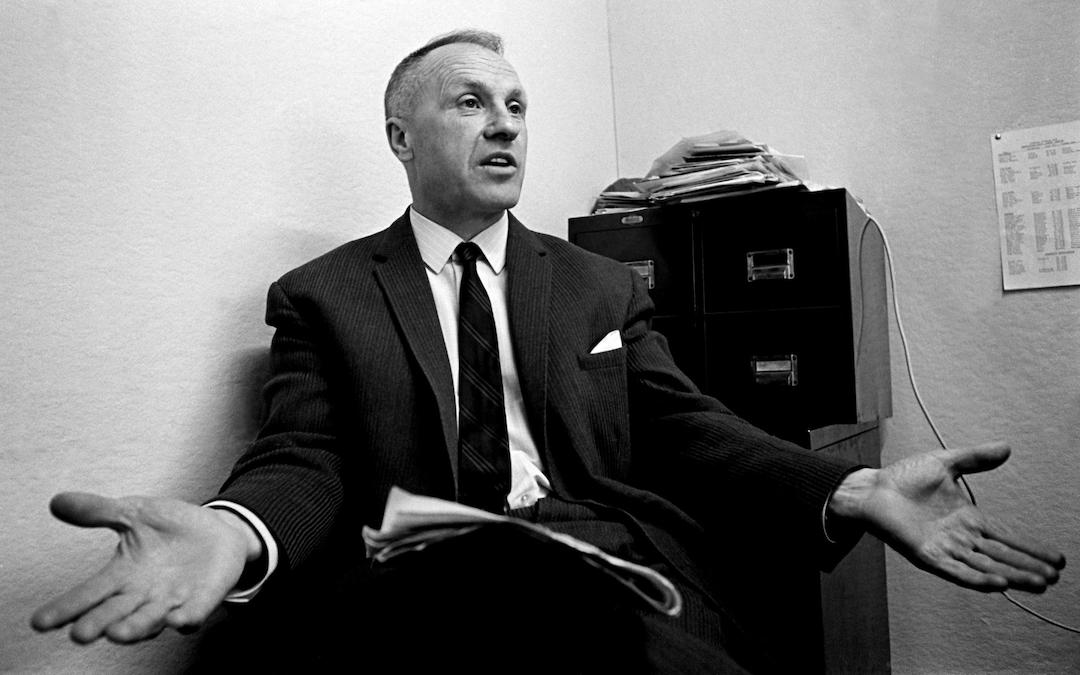 Liverpool manager Bill Shankly questions a newspaper report