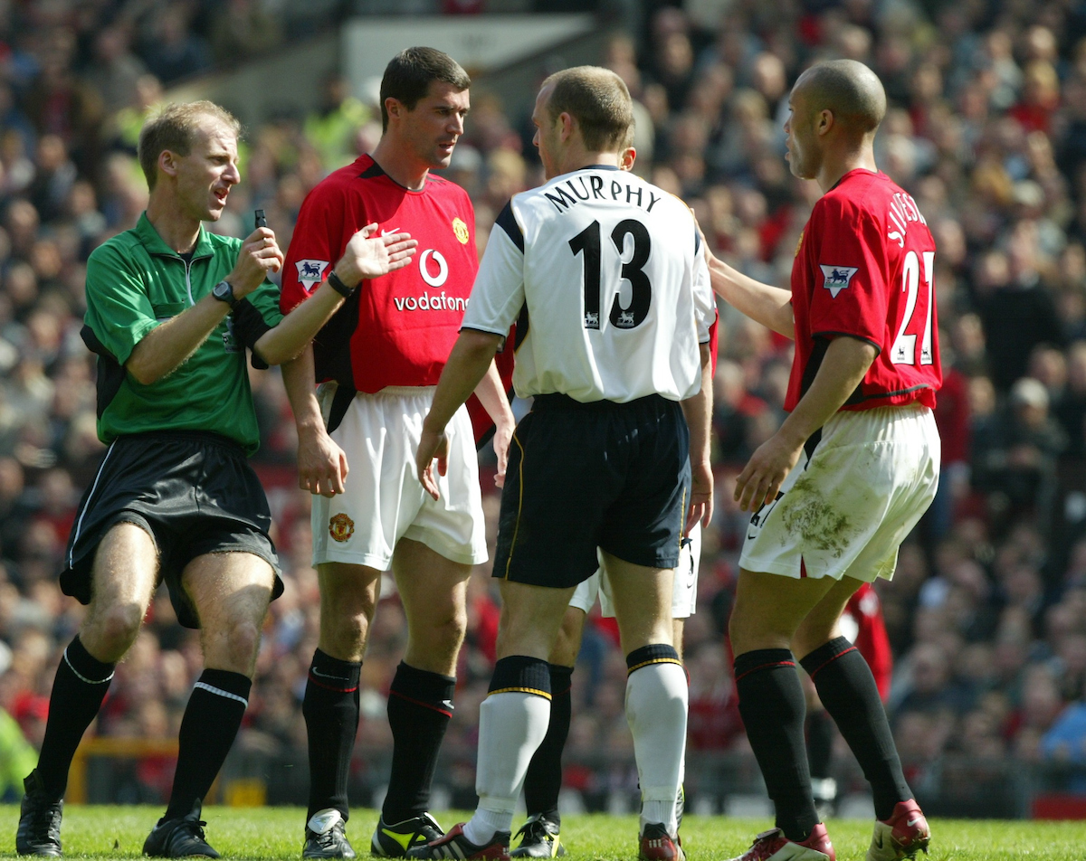 Manchester United's Roy Keane and Liverpool's Danny Murphy during the Premiership match at Old Trafford