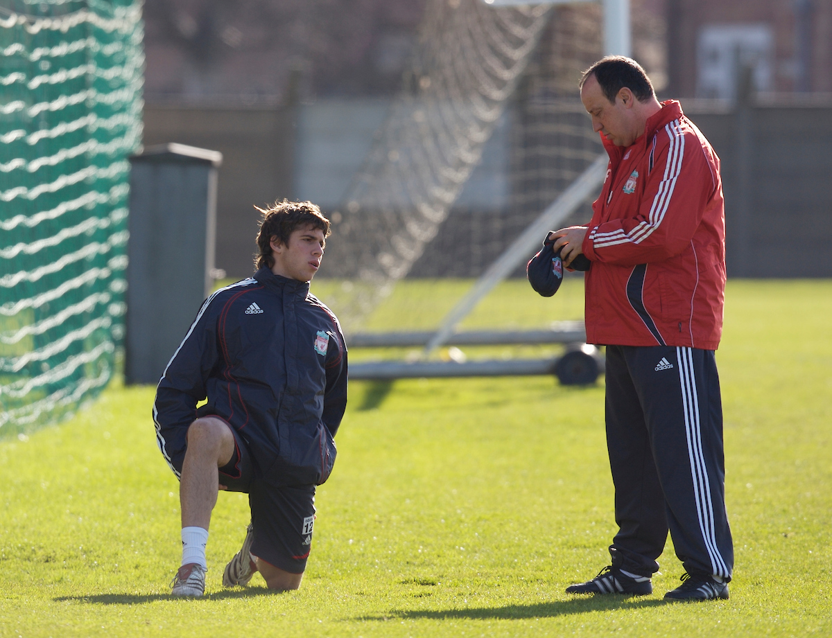 Liverpool's manager Rafael Benitez and youngster Emiliano Insua before training at Melwood ahead of the Premiership match against Manchester United