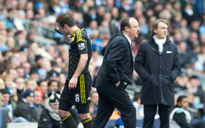 Chelsea's Frank Lampard walks off dejected past manager Rafael Benitez as he is substituted against Manchester City during the Premiership match at the City of Manchester Stadium
