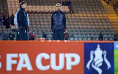 Liverpool's manager Jürgen Klopp inspects the pitch before the FA Cup