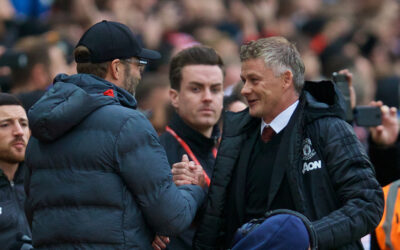 Liverpool's manager Jürgen Klopp (L) shakes hands with Manchester United's manager Ole Gunnar Solskjær during the FA Premier League match between Manchester United FC and Liverpool FC