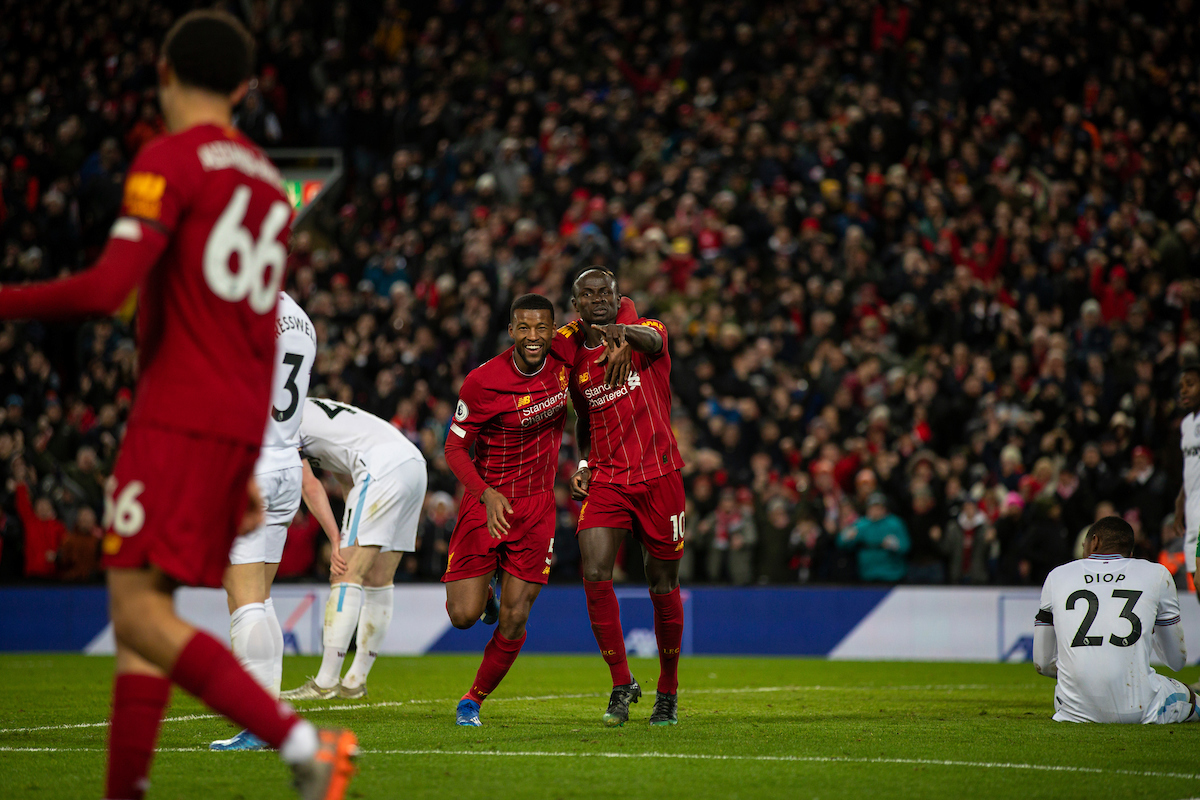 Liverpool's Sadio Mané (R) celebrates with Georginio Wijnaldum during the FA Premier League match between Liverpool FC and West Ham United FC at Anfield