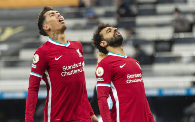 Liverpool's Mohamed Salah and Roberto Firmino look dejected after missing a chance during the FA Premier League match between Newcastle United FC and Liverpool FC at St. James' Park