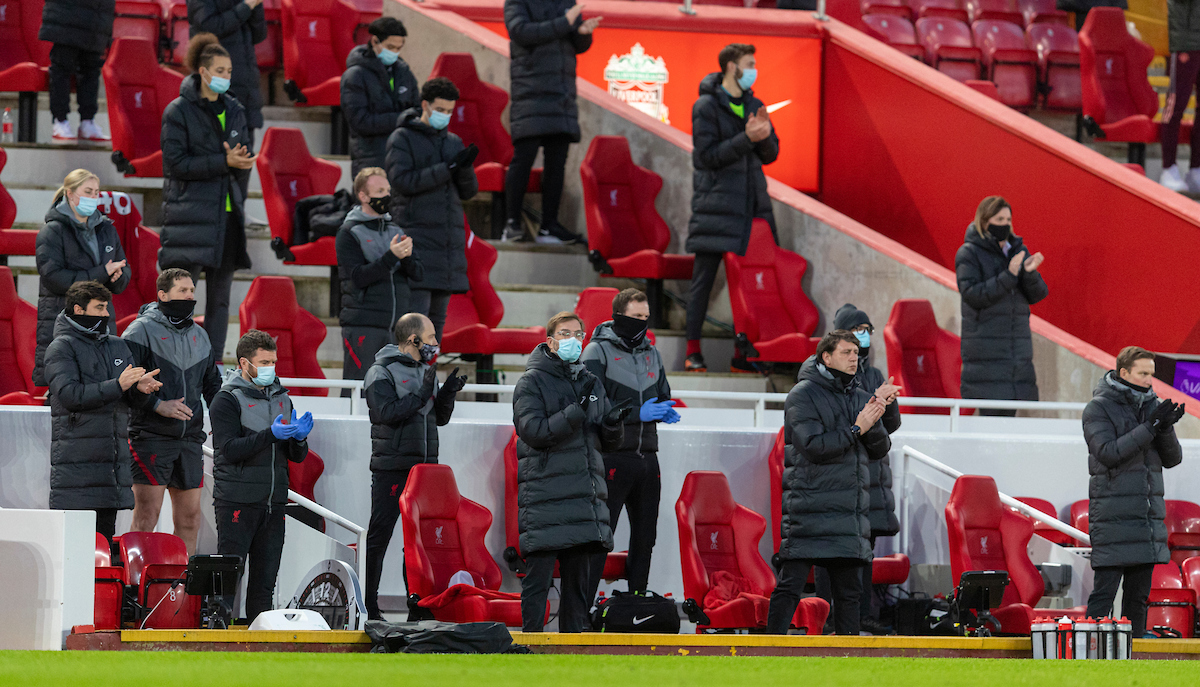 Liverpool's manager Jürgen Klopp and his substitutes and staff stand for a minute's applause to remember the late Gerry Marsden before the FA Premier League match between Liverpool FC and Manchester United FC at Anfield