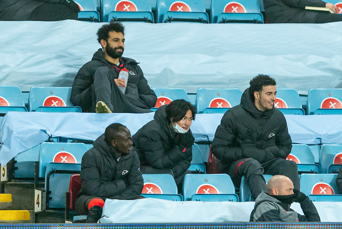 Liverpool's substituted players Sadio Mané, Mohamed Salah. Takumi Minamino anmd Curtis Jones sit in the stands during the FA Cup 3rd Round match between Aston Villa FC and Liverpool FC at Villa Park