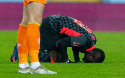Liverpool's Sadio Mané kneels to pray as he celebrates after scoring the first goal during the FA Cup 3rd Round match between Aston Villa FC and Liverpool FC at Villa Park