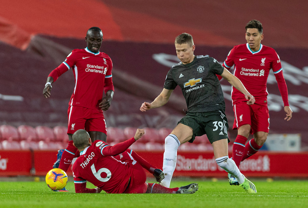 Manchester United's Scott McTominay (R) tackles Liverpool's Thiago Alcantara during the FA Premier League match between Liverpool FC and Manchester United FC at Anfield
