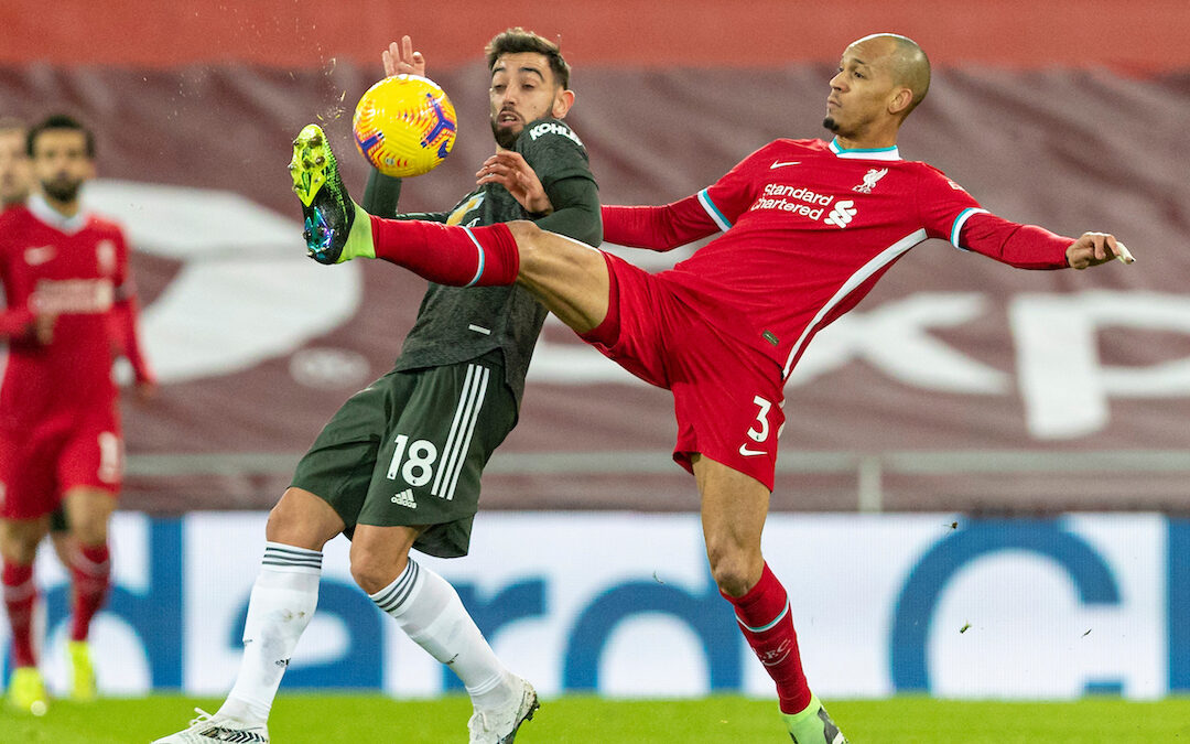 Liverpool's Fabio Henrique Tavares 'Fabinho' (R) and Manchester United's Bruno Fernandes during the FA Premier League match between Liverpool FC and Manchester United FC at Anfield