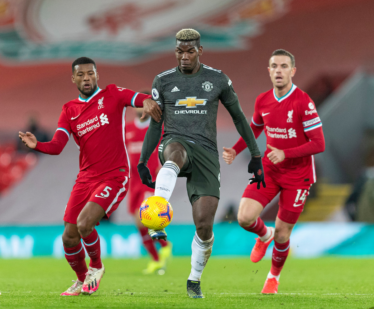Manchester United's Paul Pogba (C) and Liverpool's Georginio Wijnaldum (L) during the FA Premier League match between Liverpool FC and Manchester United FC at Anfield