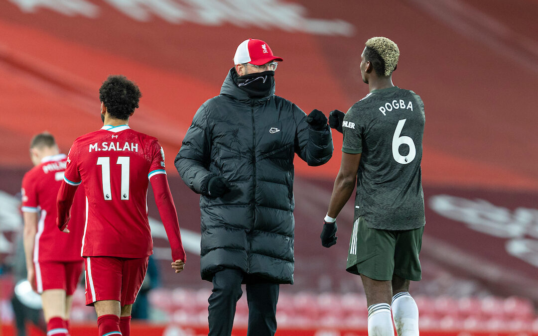 Liverpool's manager Jürgen Klopp (L) fist bumps Manchester United's Paul Pogba during the FA Premier League match between Liverpool FC and Manchester United FC at Anfield
