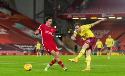 Burnley's Ashley Barnes shoots under pressure from Liverpool's Trent Alexander-Arnold during the FA Premier League match between Liverpool FC and Burnley FC at Anfield