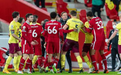 Liverpool's first-team development coach Pepijn Lijnders and Burnley's James Tarkowski clash at half-time during the FA Premier League match between Liverpool FC and Burnley FC at Anfield