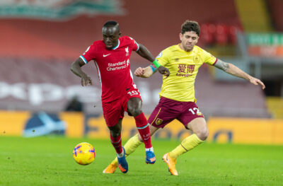 Liverpool's Sadio Mané (L) and Burnley's Robbie Brady during the FA Premier League match between Liverpool FC and Burnley FC at Anfield