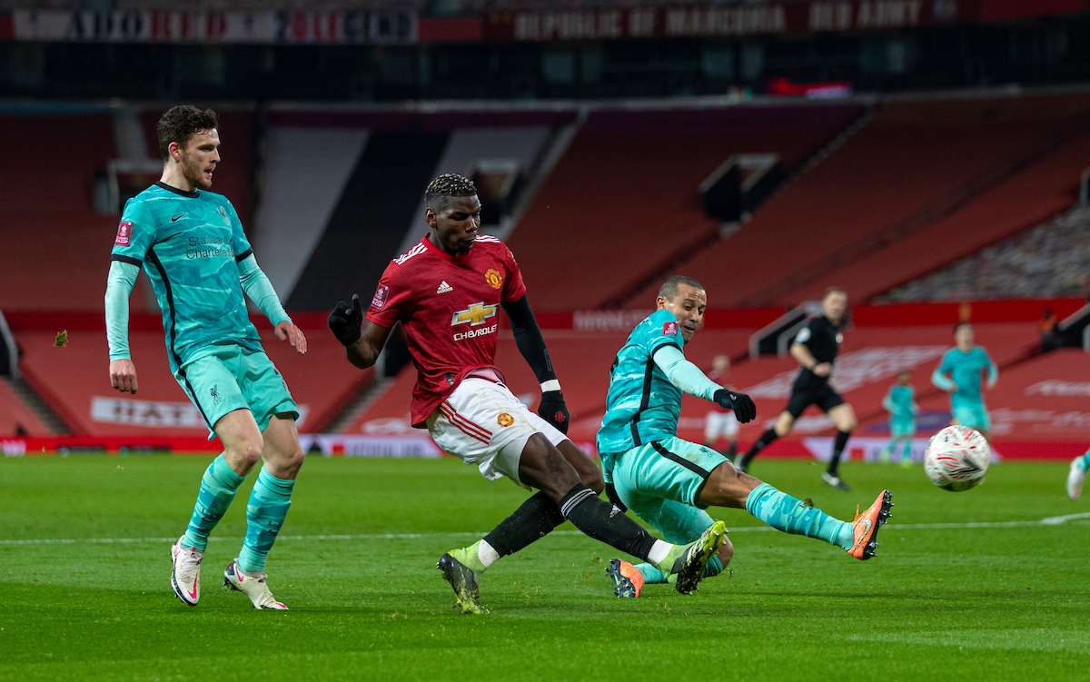 Manchester United's Paul Pogba (C) with Liverpool's Andy Robertson (L) and Thiago Alcantara (R) during the FA Cup 4th Round match between Manchester United FC and Liverpool FC at Old Trafford