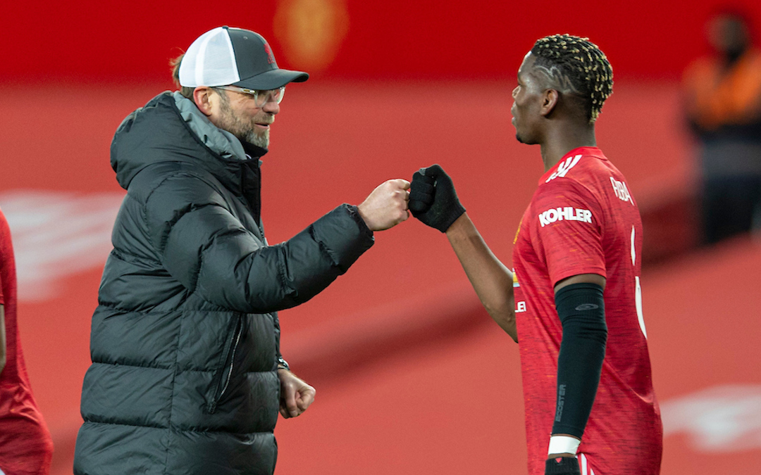 Liverpool's manager Jürgen Klopp with Manchester United's Paul Pogba after the FA Cup 4th Round match between Manchester United FC and Liverpool FC at Old Trafford