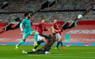 Liverpool's Mohamed Salah scores the first goal chipping the ball over Manchester United's goalkeeper Dean Henderson during the FA Cup 4th Round match between Manchester United FC and Liverpool FC at Old Trafford