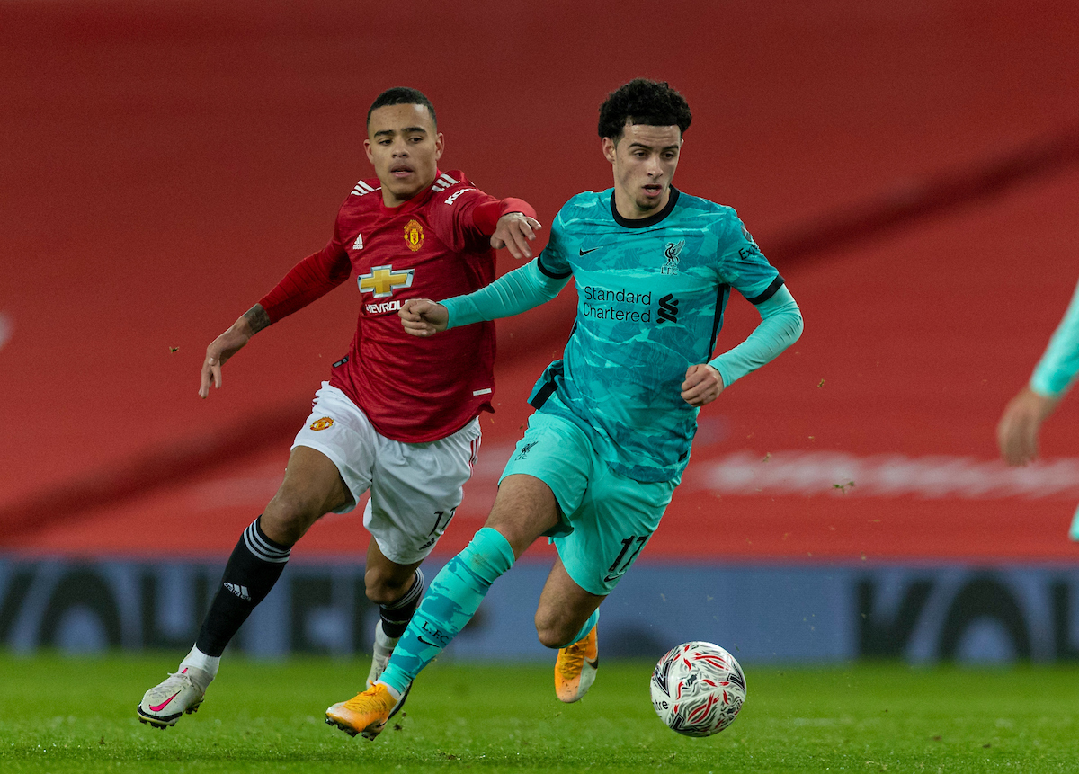 Liverpool's Curtis Jones (R) and Manchester United's Mason Greenwood during the FA Cup 4th Round match between Manchester United FC and Liverpool FC at Old Trafford
