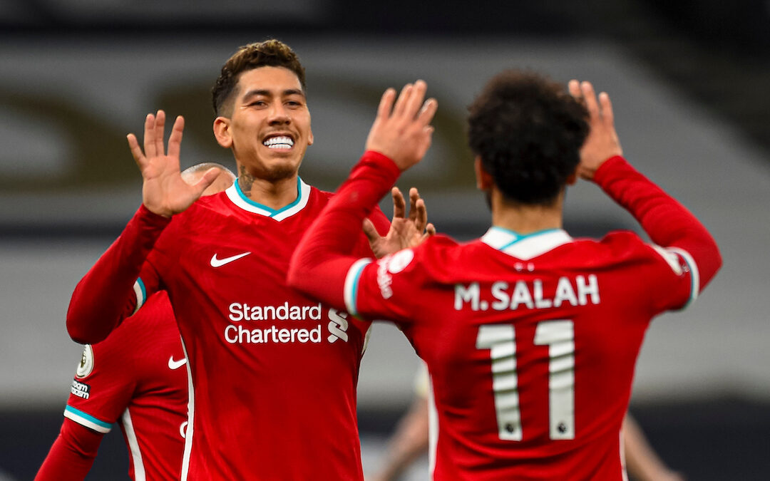 Liverpool's Roberto Firmino (L) celebrates with team-mate Mohamed Salah (R) after scoring the first goal with the last kick of the first half during the FA Premier League match between Tottenham Hotspur FC and Liverpool FC at the Tottenham Hotspur Stadium
