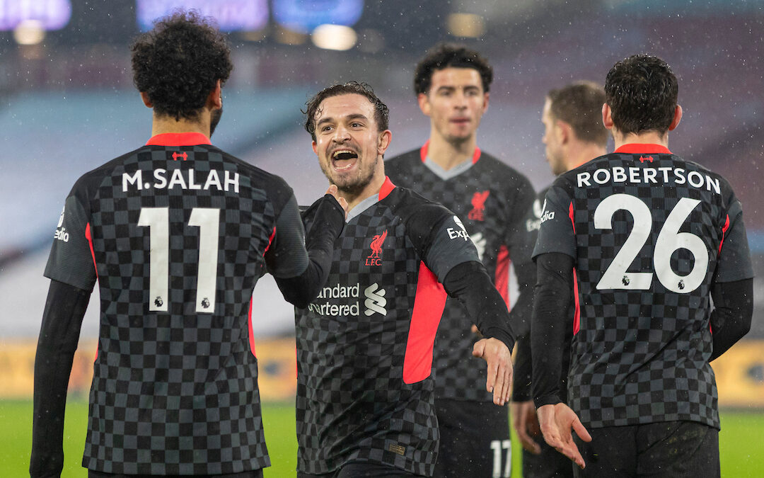 Liverpool's Mohamed Salah celebrates with team-mate captain Jordan Henderson (R) after scoring the second goal during the FA Premier League match between West Ham United FC and Liverpool FC at the London Stadium