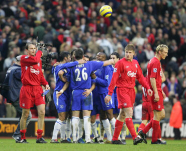 Chelsea's players celebrate their 1-0 victory as Liverpool players walk off dejected after the Premiership match at Anfield