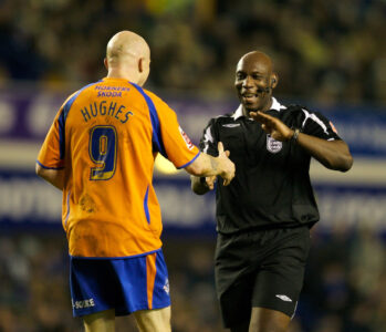 Oldham Athletic's Lee Hughes and referee Uriah Rennie his side's 1-0 victory over Everton during the FA Cup 3rd Round match at Goodison Park