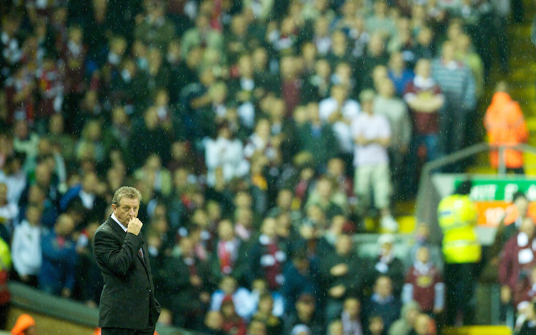 Liverpool's manager Roy Hodgson stand aimlessly as his side crash out to League Two side Northampton Town during the Football League Cup 3rd Round match at Anfield