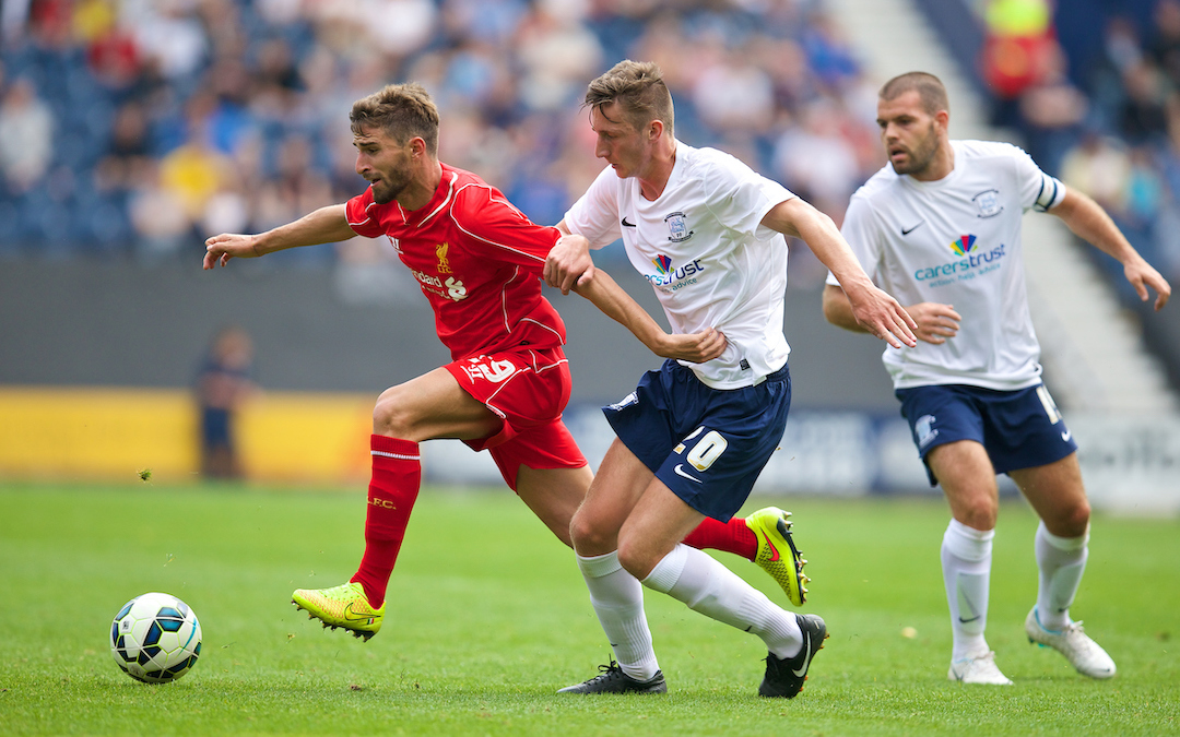 Liverpool's Fabio Borini in action against Preston North End's Ben Davies during a preseason friendly match at Deepdale Stadium