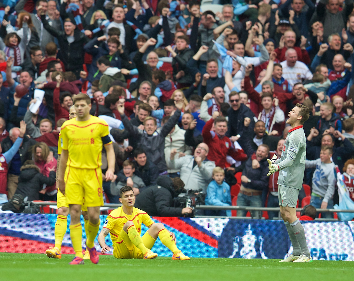 Liverpool's Dejan Lovren and goalkeeper Simon Mignolet look dejected as Aston Villa score the second goal during the FA Cup Semi-Final match at Wembley Stadium