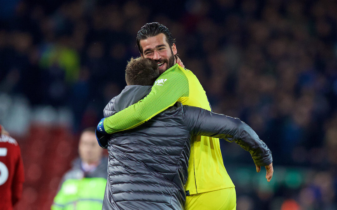 Liverpool's goalkeeper Alisson Becker and Xherdan Shaqiri celebrate after the FA Premier League match between Liverpool FC and Everton FC at Anfield, the 232nd Merseyside Derby