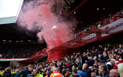 Liverpool supporters set off a red smoke bomb as they celebrate their side's winning goal during the FA Premier League match between Sheffield United FC and Liverpool FC at Bramall Lane