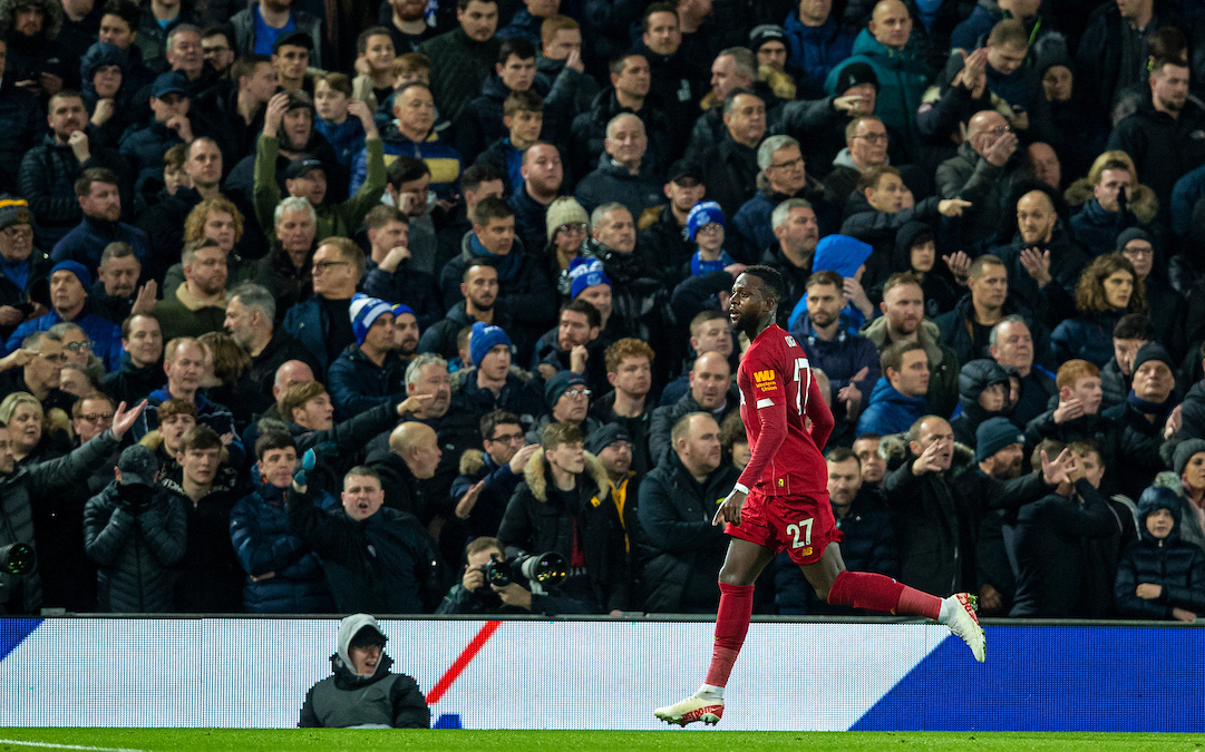 Liverpool's Divock Origi celebrates scoring the third goal, his second of the game, as Everton supporters look dejected during the FA Premier League match between Liverpool FC and Everton FC, the 234th Merseyside Derby, at Anfield
