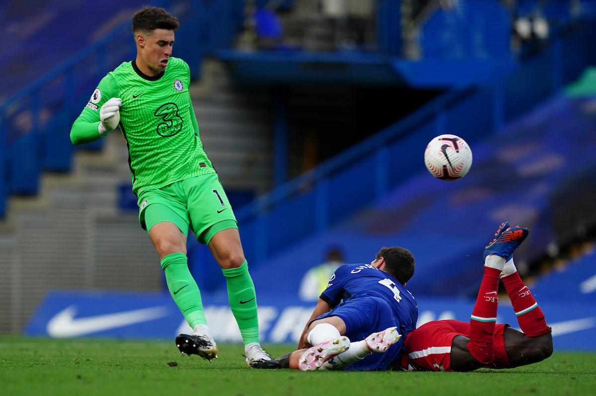 Liverpool's Sadio Mané is fouled by Chelsea's captain Andreas Christensen, who was later shown a red card after a VAR review, during the FA Premier League match between Chelsea FC and Liverpool FC at Stamford Bridge