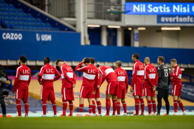Liverpool players wearing warm-up jackets line-up before the FA Premier League match between Everton FC and Liverpool FC, the 237th Merseyside Derby, at Goodison Park